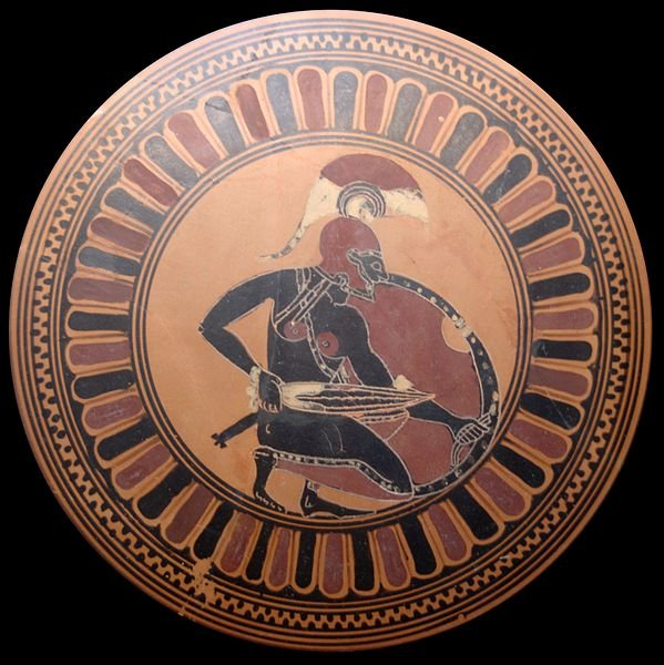 Knelt warrior with decladded sword: Achilles waiting for Troilus? Tondo of an Attic black-figure kylix, ca. 560 BC.