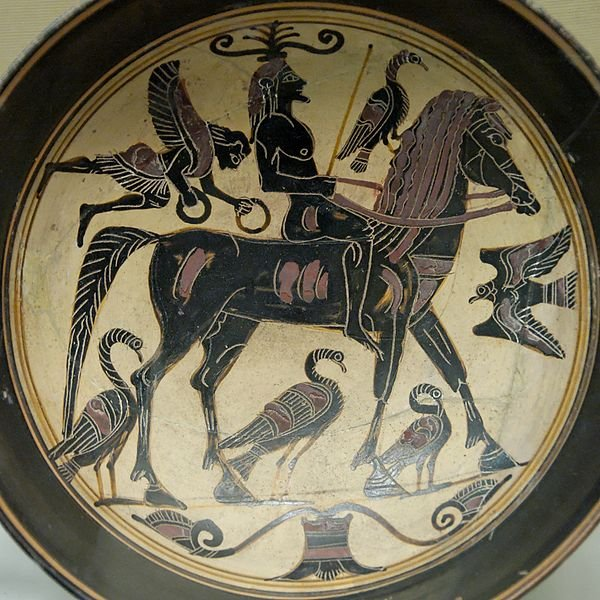 Rider with birds and a winged figure, perhaps Nike (Victory). Lakonian black-figured kylix, ca. 550–530 BC.
